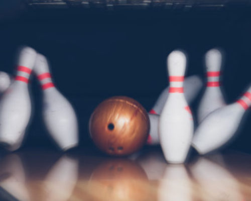 motion blur of bowling ball and skittles on the playing field